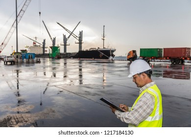 Marine transportation, foreman working with tablet, Cargo Freight Shipping for import export, container boxes at cargo, Logistics Industry, selective focus