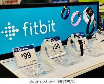 Marinette, WI / USA. - Aug 30, 2019 :   Fitbit watches for sale in store. Fitbit is an American company headquartered in San Francisco, products for activity trackers that measure data in fitness