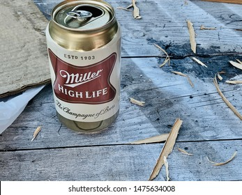marinette, WI/ USA - February 5, 2019: open can of Miller high life beer can be placed on a wooden table. a product of the Miller Brewing Company