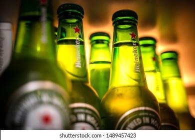 Marinette,WI / U.S.A. - Aug16,2019: Cold bottles of Heineken Beer with drops over green background. Heineken is the flagship product of Heineken International