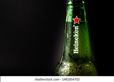 Marinette,WI/U.S.A.-Aug16-2019: Bottle of Heineken Beer on Black background. Heineken is the flagship product of Heineken International and sold in Thailand as a popular product in Southeast Asia.