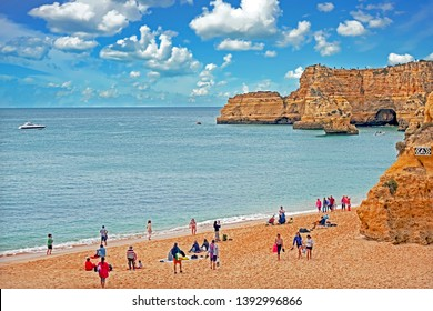Marinha, Portugal - April 23, 2019: Tourists visiting Praia da Marinha in the Algarve Portugal