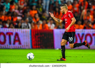Mario Gjurovski (red)of SCG Muangthong United in action during The Football Thai League match between SCG Muangthong United and PT Prachuap F.C.at SCG Stadium on February24,2019 in Nonthaburi,Thailan
