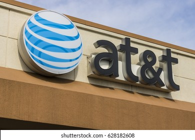 Marion - Circa April 2017: AT&T Corporate logo and signage on a mobility store. AT&T now offers Uverse, VoIP, Cell Phones and DirecTV XVI