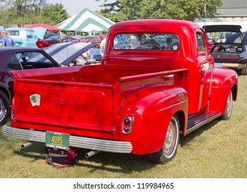 MARION, WI - SEPTEMBER 16: 1952 Red Ford Pickup Truck at the 3rd Annual Not Just Another Car Show on September 16, 2012 in Marion, Wisconsin.