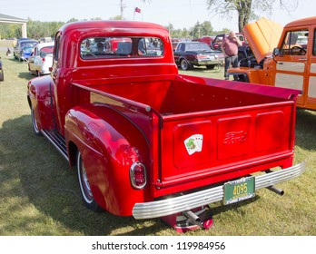 MARION, WI - SEPTEMBER 16: Back of 1952 Red Ford Pickup Truck at the 3rd Annual Not Just Another Car Show on September 16, 2012 in Marion, Wisconsin.