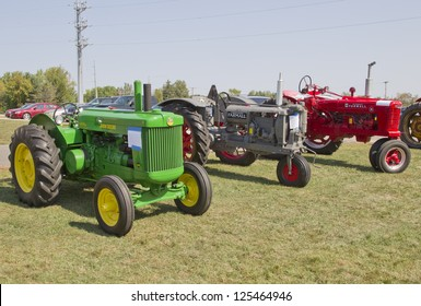 MARION, WI - SEPTEMBER 16: Three Antique Tractors at the 3rd Annual Not Just Another Car Show on September 16, 2012 in Marion, Wisconsin.