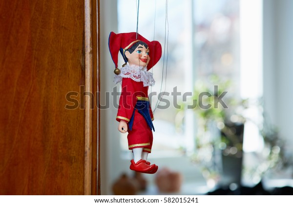 Marionette of clown, jolly joker,  interior