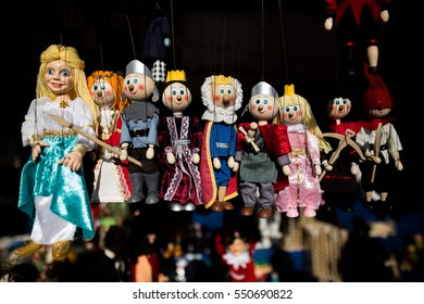 Marionette kingdom figures, puppets, royal court tale characters, princess, knight, warrior, soldier, king, prince hanging on rope, handmade colorful toys for children