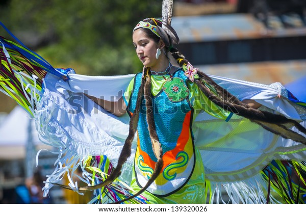 MARIPOSA ,USA - MAY 11 : An unidentified Native Indian dancer takes part at the Mariposa 20th annual Pow Wow in California , USA on May 11 2013 ,Pow wow is native American cultural gathernig event.