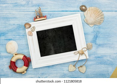 Maritime background, with sea shells, safety belt, fishing boat and chalkboard in white frame with copy space
