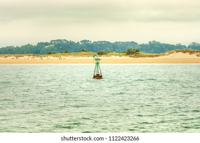 Maritime information buoy in front of the beach of Somo, in Cantabria, Spain