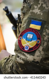 "MARIUPOL, UKRAINE - APRIL, 23 2015. Ukrainian soldier with chevron on the uniform. The text on the chevron: ""We will win. Sector M (Mariupol) ATO (Anti-Terrorist Operation)"""