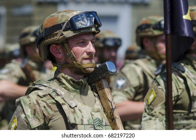 MARIUPOL, UKRAINE - JUN, 17 2017. Military march of Ukranian soldiers. Soldier with symbolical Hammer of Thor. That day three years ago Mariupol was cleared from pro-Russian separatists.