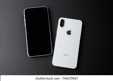 MARIUPOL,UKRAINE - 27 OCTOBER,2017: New Iphone X model close up.Modern cellphone with touch screen and dual camera lens.Trendy Apple Iphone 10 case