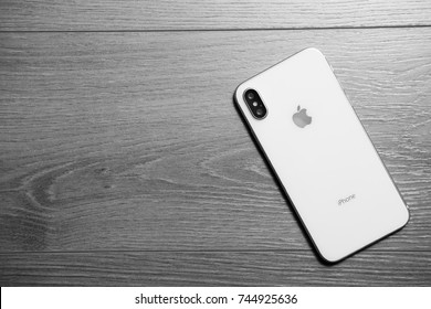 MARIUPOL,UKRAINE-30 OCTOBER,2017: New Iphone X smart phone in close up.Latest Apple Iphone 10 mobile phone model.Illustrative editorial black and white