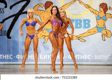 MARIUPOL,UKRAINE-30 SEPTEMBER,2017:Fitness bikini contest UFBB.Beautiful tanned athletic young women.Sporty woman in bikini on stage.Slim fit girl in sport underwear on scene.Fit female bodies in tan