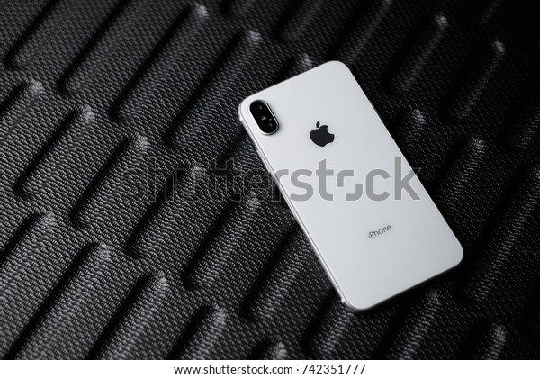 MARIUPOL,UKRAINE-5 OCTOBER,2017:Beautiful newest iphone x smart phone model.Trendy white iphone 10 model.Modern cellphone with dual photo camera lenses & tempered glass