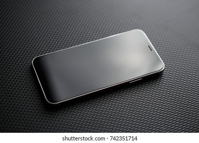 MARIUPOL,UKRAINE-5 OCTOBER,2017:Newest Apple Iphone X concept with big black infinity edge touch screen.New Iphone 10 phone model with empty black touch screen