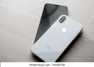 MARIUPOL,UKRAINE-7 OCTOBER,2017:New 2018 top Iphone X cellphones.Modern mobile phones with infinity edge touch screen & double camera lenses.Trendy Apple Iphone 10 in luxury white tempered glass case