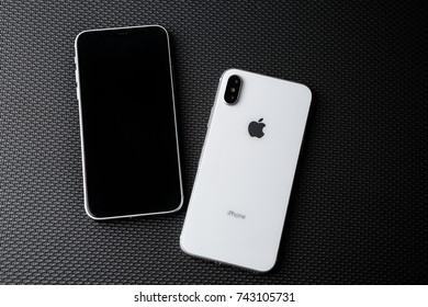 MARIUPOL,UKRAINE-7 OCTOBER,2017:New Iphone X smartphones.Buy modern mobile phone with infinity edge touch screen,dual camera lenses & white tempered glass case.Trendy Apple Iphone 10