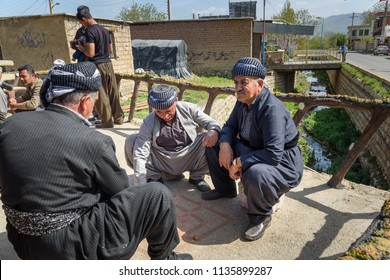 Marivan, Kurdistan Province, Iran - April 6, 2018: Kurdish men in Darreh Tafi village near Zarivar lake. Darreh Tafi village, 15kms west of Marivan, is home to large number of white storks in spring