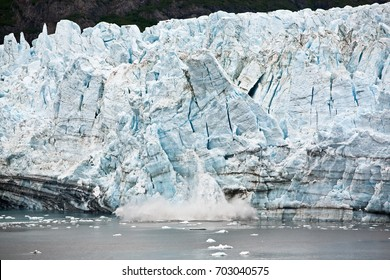 /Marjorie Glacier is Calving/Marjorie Glacier in Glacier Bay, Alaska. Wall of snow is calving. Small boat in foreground shows size.