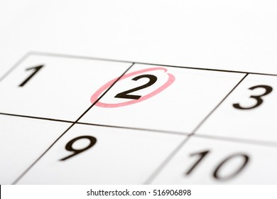 Mark the date number second. The second day of the month is marked with a red circle. Focus point on the marked number.