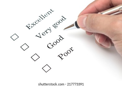 Mark Excellent or very good with pen on survey paper document