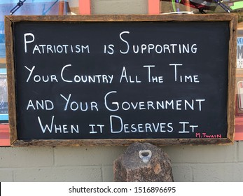 Mark Twain patriotism quote on a chalk board.