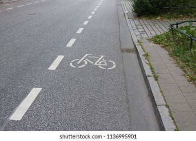 Marked bicycle lane on a paved, asphalt road in Germany, no people.