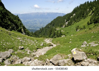 a marked mountain trail and blue sky