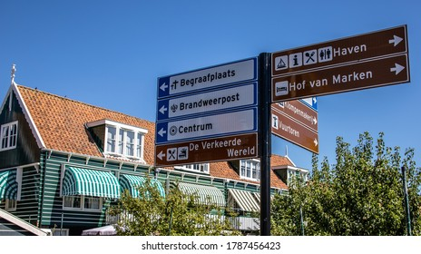 Marken, the Netherlands - July 31 2020: signpost in  Marken. Center, harbor and cemetery, Part of a serie.