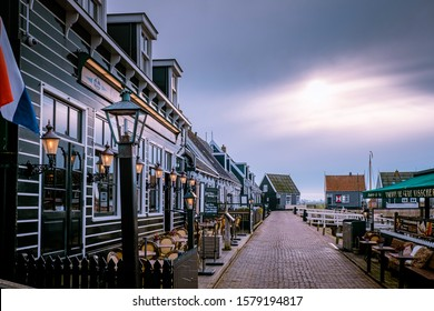 Marken Netherlands October 2019, small fishing village with green house at the harbour in Marken