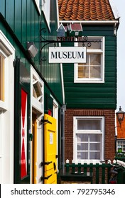 MARKEN, NORTH HOLLAND, NETHERLANDS - April 07, 2013: Ethnographic museum of the island of Marken on the Kerkbuurt street in typical wooden green houses is a tourist attraction of the town