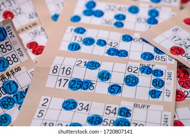marker bingo cards piled up close up