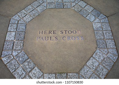 A marker on the ground in the churchyard of St. Pauls Cathedral in London, marking the location where Pauls Cross once stood.