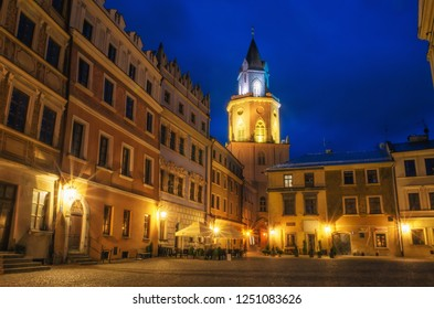 Market with The Archdiocesan Museum of Religious Art in The Trinitary Tower in Lublin old town at night, Poland