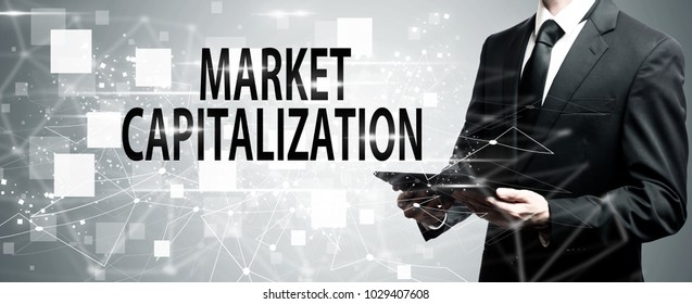 Market Capitalization with man holding a tablet computer
