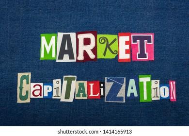 MARKET CAPITALIZATION text word collage, multi colored fabric on blue denim, market value concept, horizontal aspect