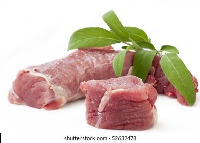A market fresh raw pork tenderloin with Sage Isolated on White