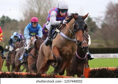 MARKET RASEN RACECOURSE, LINCOLNSHIRE, UK : 6 DECEMBER 2018 : Racehorses jump the last hurdle whilst racing at Market Rasen Races