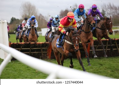MARKET RASEN RACECOURSE, LINCOLNSHIRE, UK : 6 DECEMBER 2018 : Racehorses jump the last hurdle whilst racing at Market Rasen Races