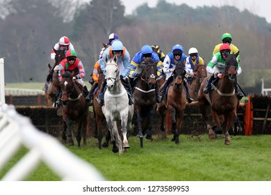 MARKET RASEN RACECOURSE, LINCOLNSHIRE, UK : 26 DECEMBER 2018 : Head on view of racehorses jumping the last fence during hurdling at Market Rasen Races