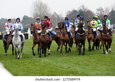 MARKET RASEN RACECOURSE, LINCOLNSHIRE, UK : 26 DECEMBER 2018 : Racehorses circle at the Start before racing during the Boxing Day Meet and Market Rasen Races