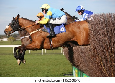 MARKET RASEN RACECOURSE, LINCOLNSHIRE, UK : 20 MARCH 2019 : Racehorse Invicta Lane ridden by jockey Richie McLernon jumps the last fence at Market Rasen Races