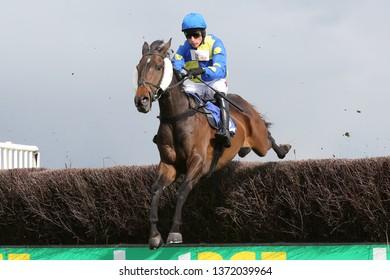 MARKET RASEN RACECOURSE, LINCOLNSHIRE, UK : 3 APRIL 2019 : Jockey Harry Skelton jumps the last fence on Embole at Market Rasen Races