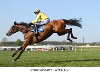 MARKET RASEN RACECOURSE, LINCOLNSHIRE, UK : 21 APRIL 2019 : Gortroe Joe ridden by jockey Harry Skelton jump the last fence at Market Rasen Races