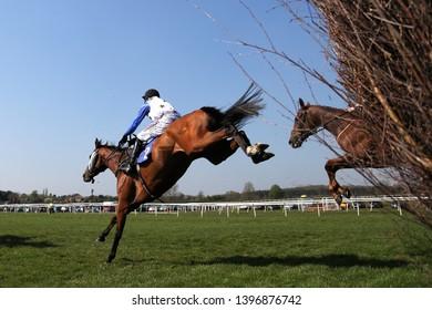 MARKET RASEN RACECOURSE, LINCOLNSHIRE, UK : 21 APRIL 2019 : Holryale ridden by jockey Harry Skelton jumps the last fence at Market Rasen Races
