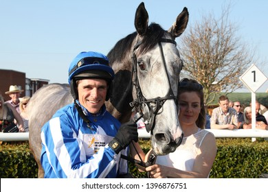 MARKET RASEN RACECOURSE, LINCOLNSHIRE, UK : 21 APRIL 2019 : Jockey Harry Skelton rides the grey Montego Grey to victory and brings up the 200th Winner in a Season for brother & Trainer Dan Skelton